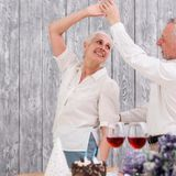 happy-senior-couple-dancing-birthday-party_23-2148196611