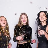happy-women-standing-with-champagne-glasses-spangles_23-2147989996