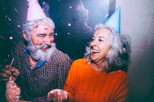 senior-couple-wearing-party-hat-head-enjoying-birthday-party_23-214809