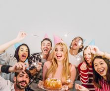 young-friends-with-birthday-cake_23-2147720226